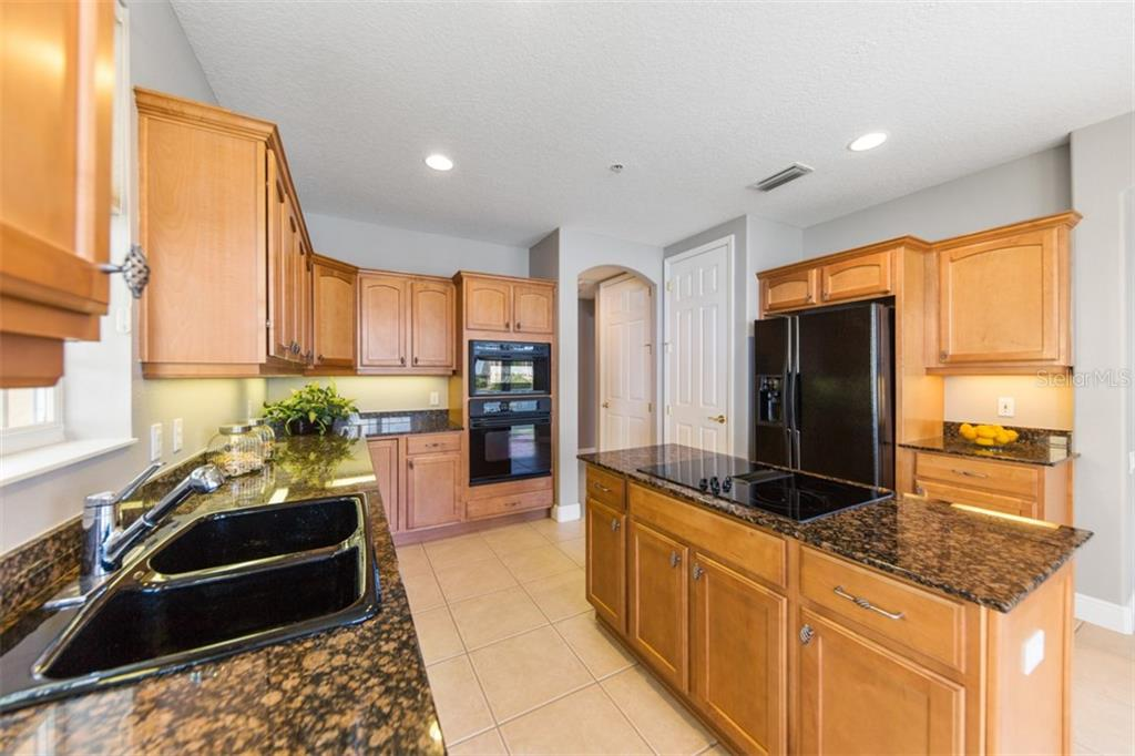 Beautiful, full-sized kitchen - lives like a single family home. - Condo for sale at 6415 Moorings Point Cir #102, Lakewood Ranch, FL 34202 - MLS Number is A4196054