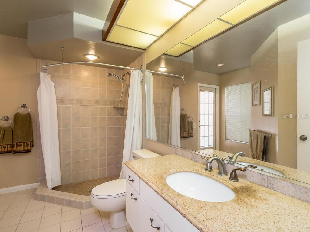 Master Suite #2 bath - also opens to pool area - Single Family Home for sale at 7520 Weeping Willow Dr, Sarasota, FL 34241 - MLS Number is A4196497