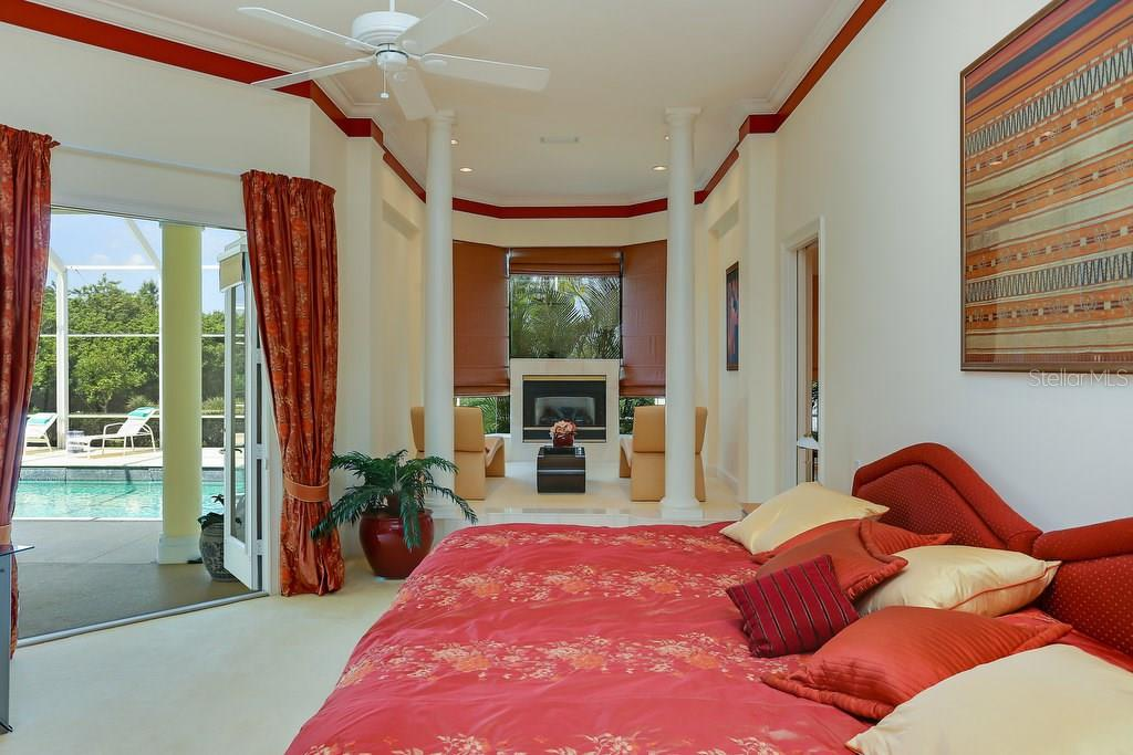 Master suite with sitting area and access to the pool & lanai - Single Family Home for sale at 7332 Chelsea Ct, University Park, FL 34201 - MLS Number is A4196805