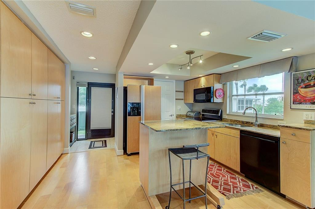 Designer Kitchen featuring granite countertops and hand-crafted maple cabinets - Condo for sale at 600 Manatee Ave #236, Holmes Beach, FL 34217 - MLS Number is A4197636