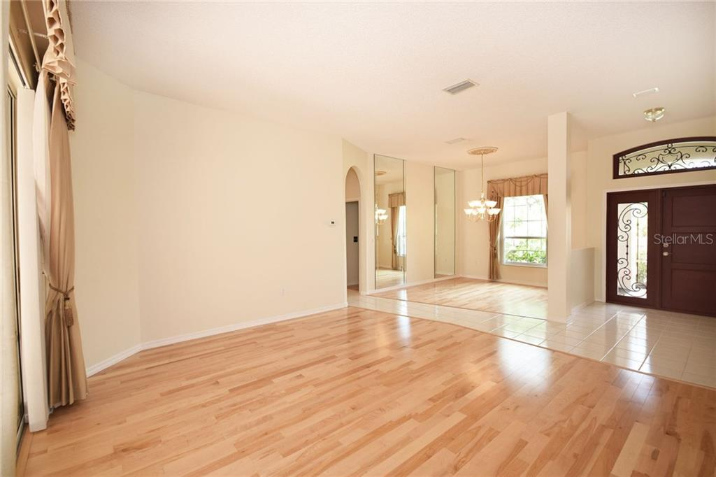 Living and Dining rooms - Single Family Home for sale at 9520 Hawksmoor Ln, Sarasota, FL 34238 - MLS Number is A4197662