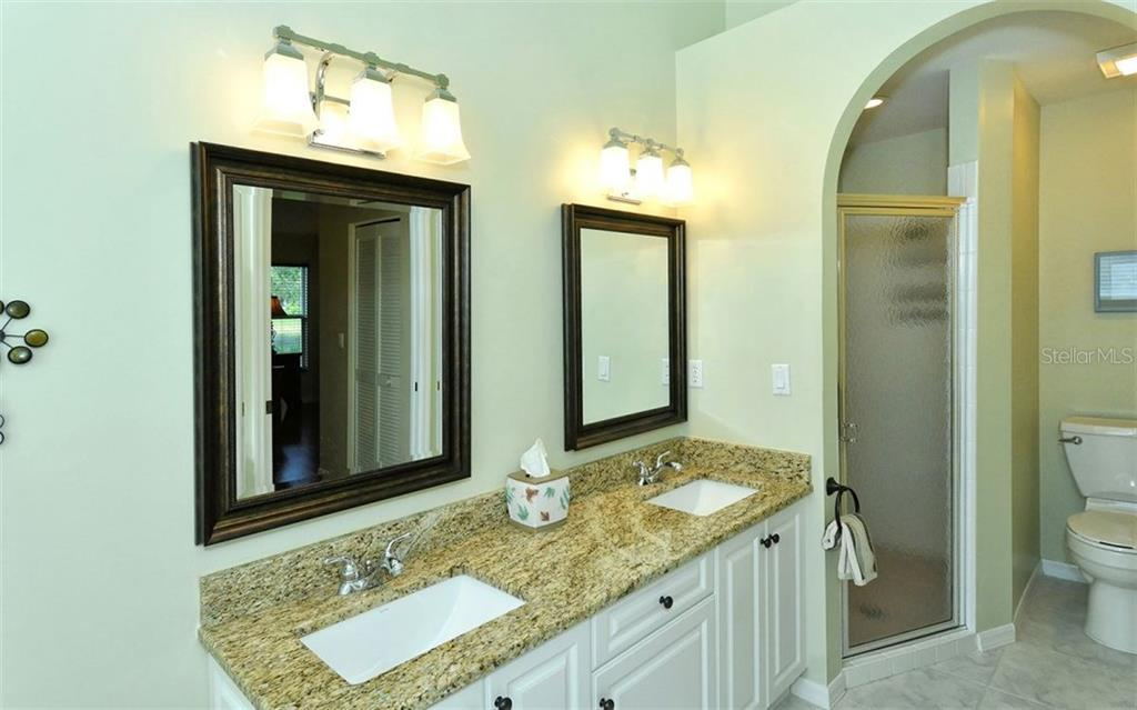 Master bath vanity area and large shower space.  Floor has been redone with ceramic tile. - Single Family Home for sale at 9571 Knightsbridge Cir, Sarasota, FL 34238 - MLS Number is A4197972