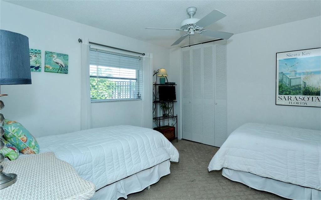Guest bedroom - Single Family Home for sale at 6308 Midnight Pass Rd #4, Sarasota, FL 34242 - MLS Number is A4198360