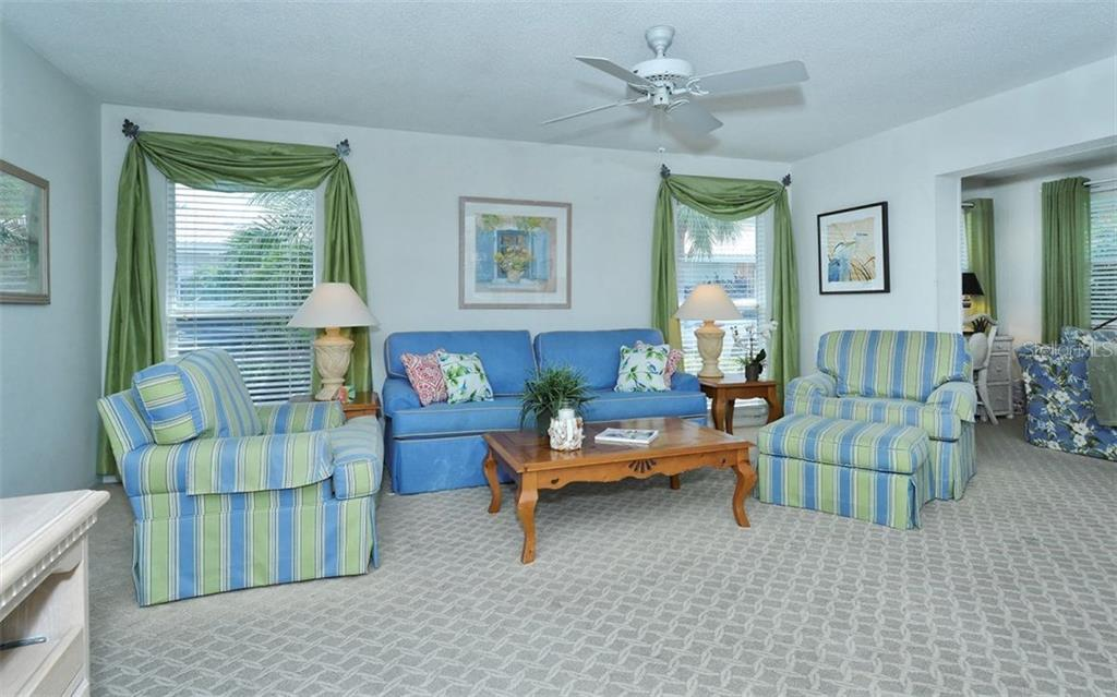 Living room - Condo for sale at 6308 Midnight Pass Rd #4, Sarasota, FL 34242 - MLS Number is A4198360