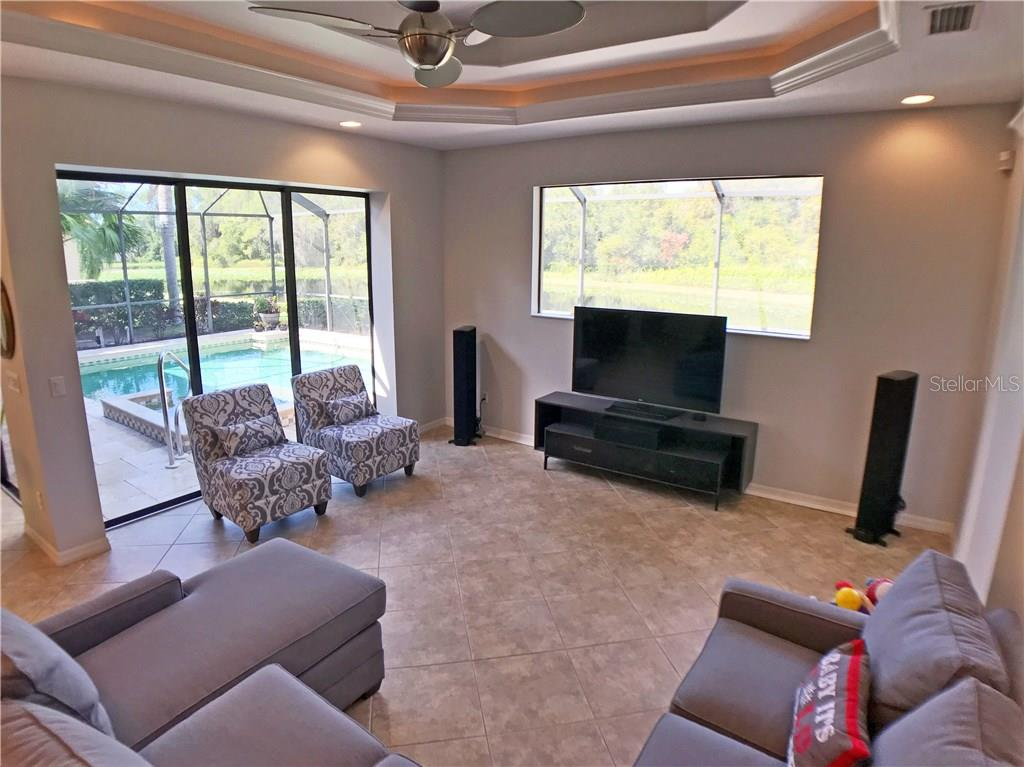 family room with views of pool, lake, and sunsets! - Single Family Home for sale at 4616 Tuscana Dr, Sarasota, FL 34241 - MLS Number is A4200517