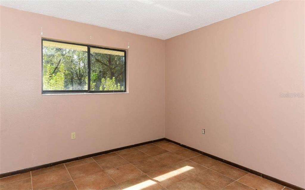 Bedroom 2 - Single Family Home for sale at 16701 Singletary Rd, Myakka City, FL 34251 - MLS Number is A4200632