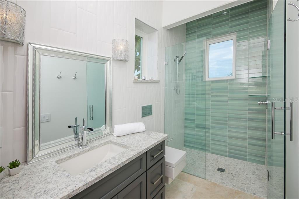 Second story en suite guest room with balcony overlooking pool and canal - Single Family Home for sale at 620 Key Royale Dr, Holmes Beach, FL 34217 - MLS Number is A4200888