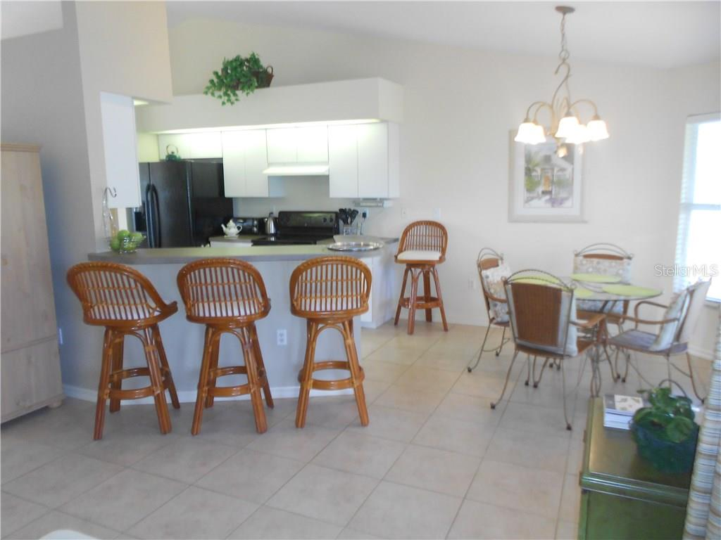 Breakfast Bar with Eat-In Kitchen - Single Family Home for sale at 6320 Hera St, Englewood, FL 34224 - MLS Number is A4200968