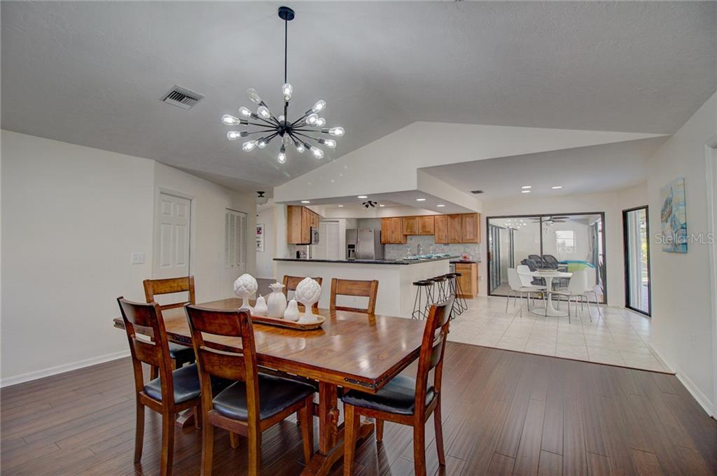 Family Room Converted into Dining Room off Kitchen - Single Family Home for sale at 1087 Hoover Cir, Nokomis, FL 34275 - MLS Number is A4201722