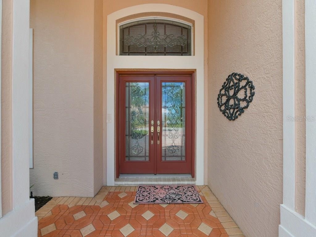 Double door with transom window entry - Single Family Home for sale at 709 Sawgrass Bridge Rd, Venice, FL 34292 - MLS Number is A4201753