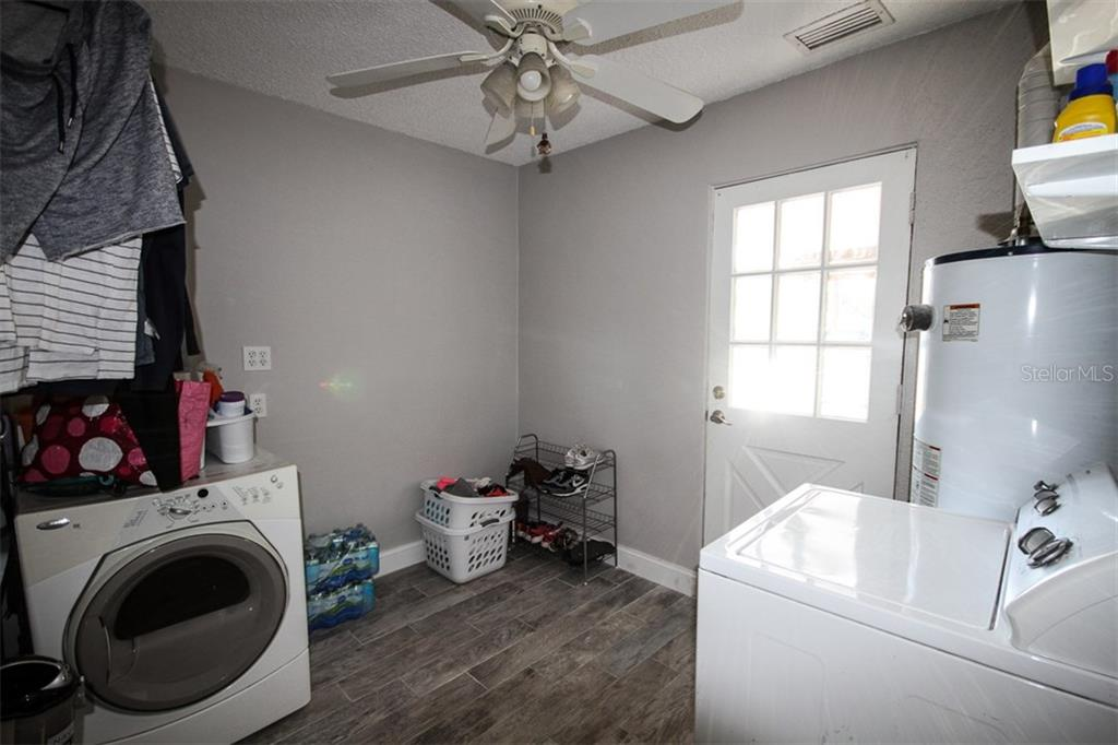 Laundry room, storage, pantry area - Single Family Home for sale at 6727 Georgia Ave, Bradenton, FL 34207 - MLS Number is A4202749