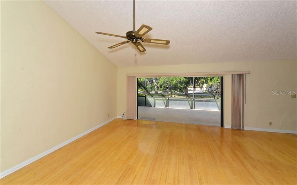 Great room with sliding pocket doors to screened in lanai. - Single Family Home for sale at 744 Tyler Dr, Sarasota, FL 34236 - MLS Number is A4203232