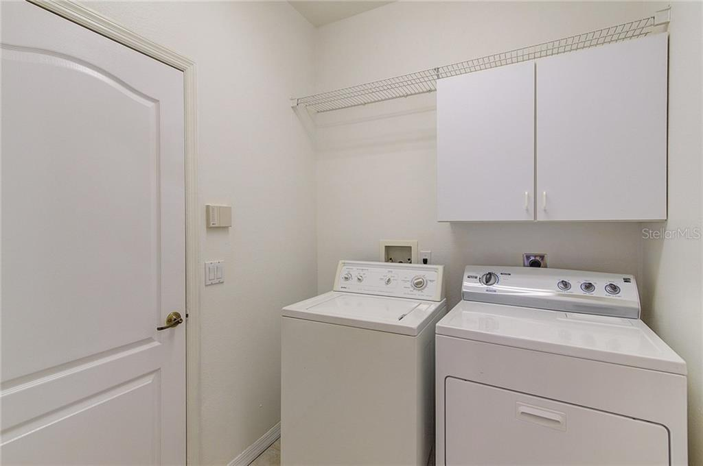 Laundry Room with shelving and cabinet - Single Family Home for sale at 530 Hunter Ln, Bradenton, FL 34212 - MLS Number is A4203433