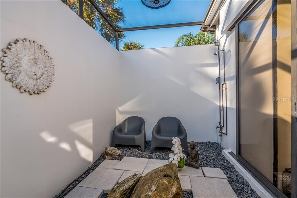 Zen Garden with Outdoor Shower - Single Family Home for sale at 5026 Kestral Park Way S, Sarasota, FL 34231 - MLS Number is A4203689