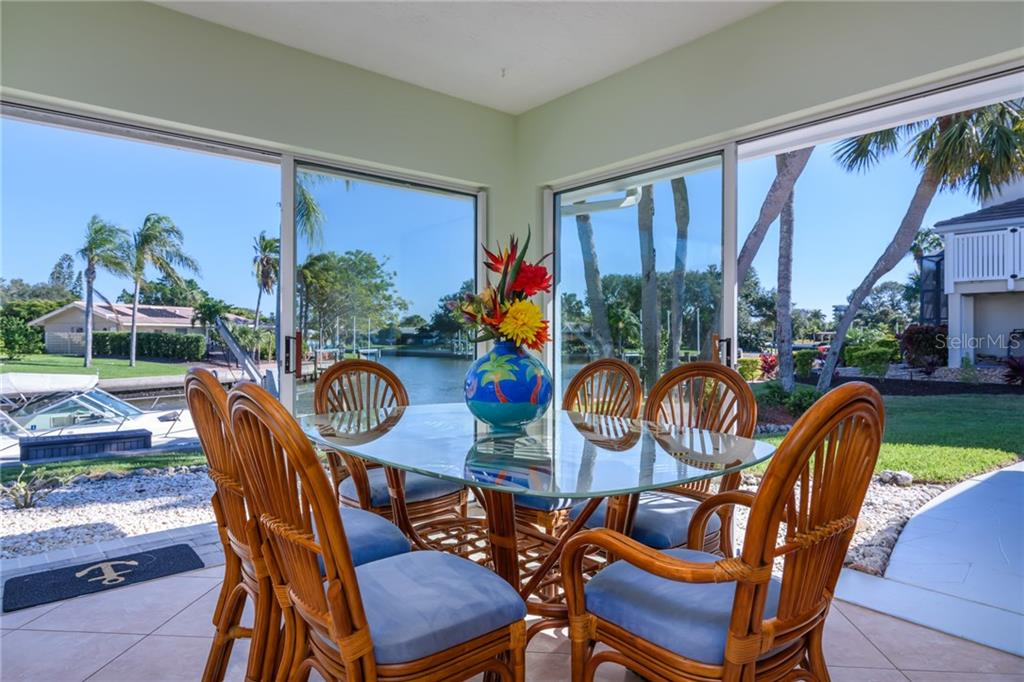 Dining area with canal view and sliders to outside - Single Family Home for sale at 5439 Azure Way, Sarasota, FL 34242 - MLS Number is A4203969