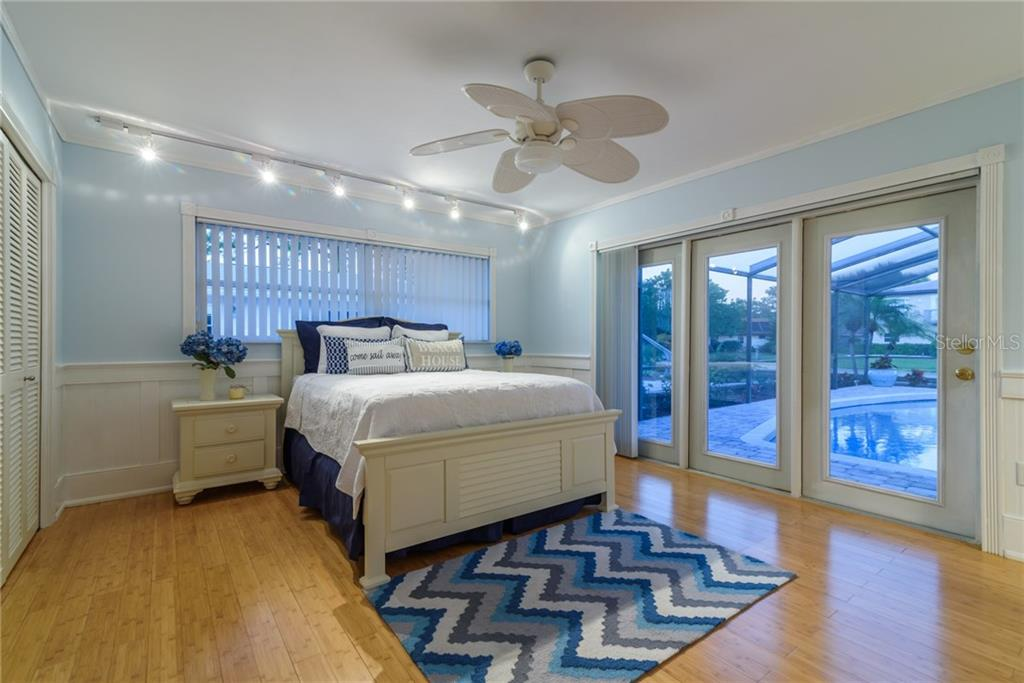 Master bedroom at dusk - Single Family Home for sale at 5439 Azure Way, Sarasota, FL 34242 - MLS Number is A4203969