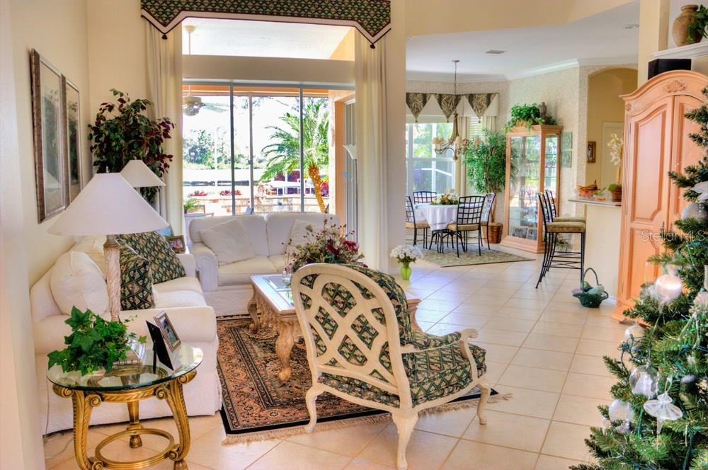 Great room with sliders to lanai - Single Family Home for sale at 508 Marsh Creek Rd, Venice, FL 34292 - MLS Number is A4204933