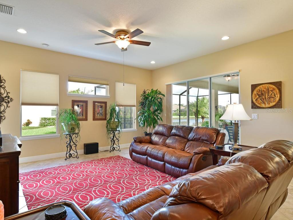 Spacious great room connected to the kitchen includes full sliders to the lanai - Single Family Home for sale at 6601 Horned Owl Pl, Sarasota, FL 34241 - MLS Number is A4205612