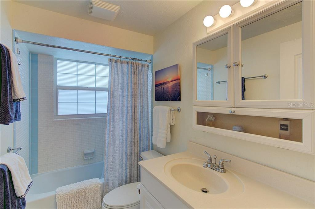 Plenty of cabinet space and natural light in the hallway bath. - Single Family Home for sale at 501 70th St, Holmes Beach, FL 34217 - MLS Number is A4205799