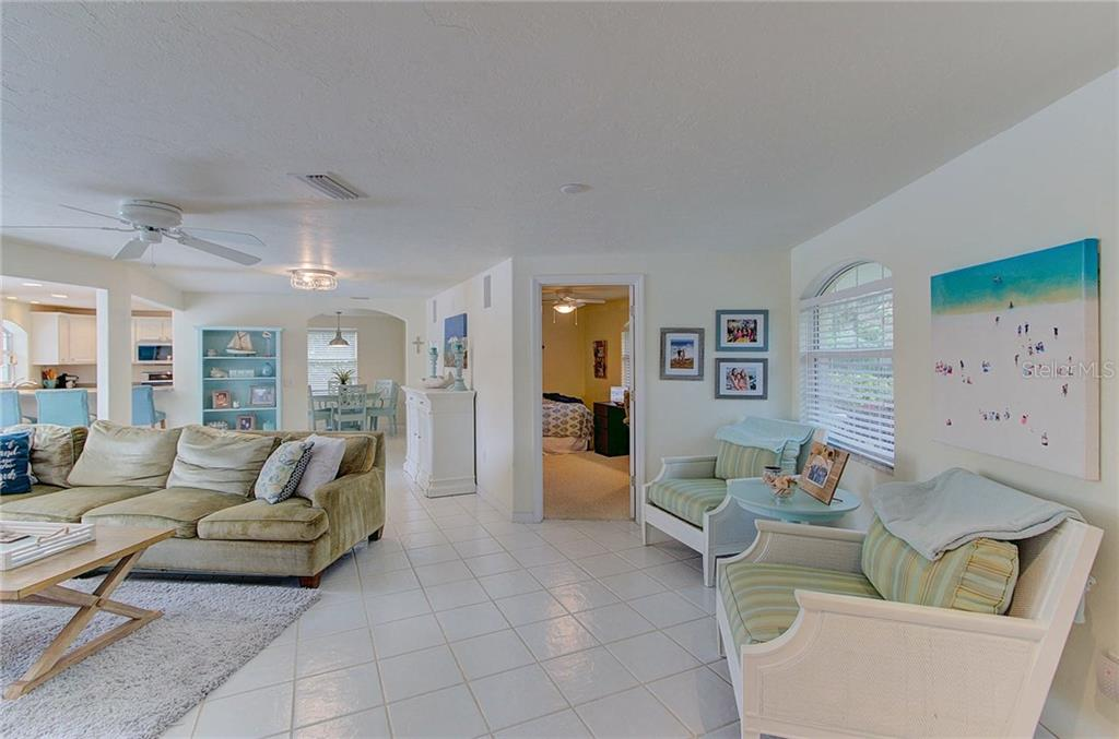 View upon entering the home of the open living area with lots of natural light. - Single Family Home for sale at 501 70th St, Holmes Beach, FL 34217 - MLS Number is A4205799