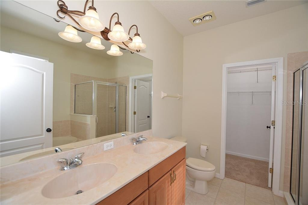 Fabulous master ensuite with pretty cabinets, dual sinks, walk-in closet, soaking tub and tiled stand alone shower. - Single Family Home for sale at 6320 Robin Cv, Lakewood Ranch, FL 34202 - MLS Number is A4205857
