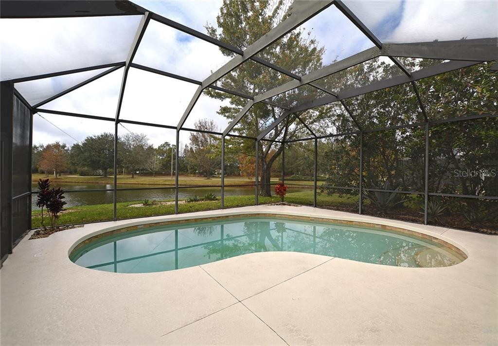 Relax on the screened lanai, take a dip in the saltwater pool and enjoy the view of the pretty lake beyond. - Single Family Home for sale at 6320 Robin Cv, Lakewood Ranch, FL 34202 - MLS Number is A4205857