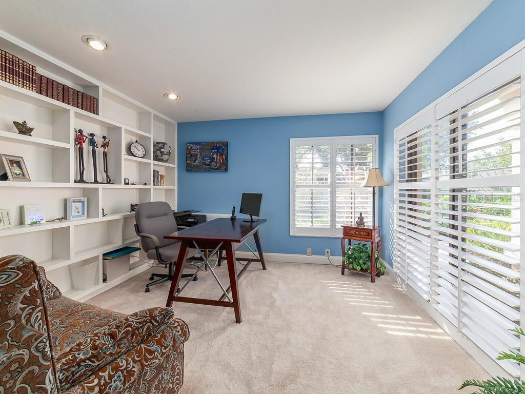 Office or 4th Bedroom, with lovely views, sliding doors with plantation shutters, closet and half bath - Single Family Home for sale at 3959 Prairie Dunes Dr, Sarasota, FL 34238 - MLS Number is A4205907