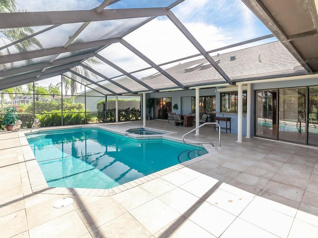 Pool and Spa, with many sliding doors - Single Family Home for sale at 3959 Prairie Dunes Dr, Sarasota, FL 34238 - MLS Number is A4205907
