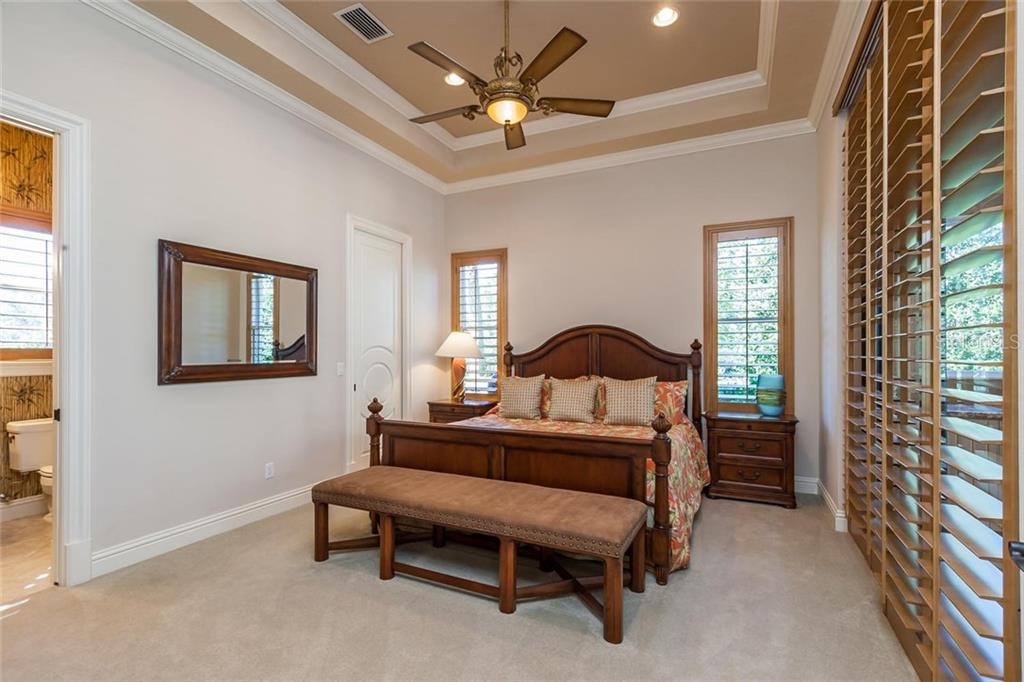 Guest bedroom suite #1 with ensuite restroom! - Single Family Home for sale at 8346 Farington Ct, Bradenton, FL 34202 - MLS Number is A4206244