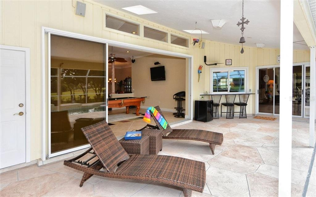 Covered area in lanai - cut thru window to kitchen - Single Family Home for sale at 3882 Spyglass Hill Rd, Sarasota, FL 34238 - MLS Number is A4206477