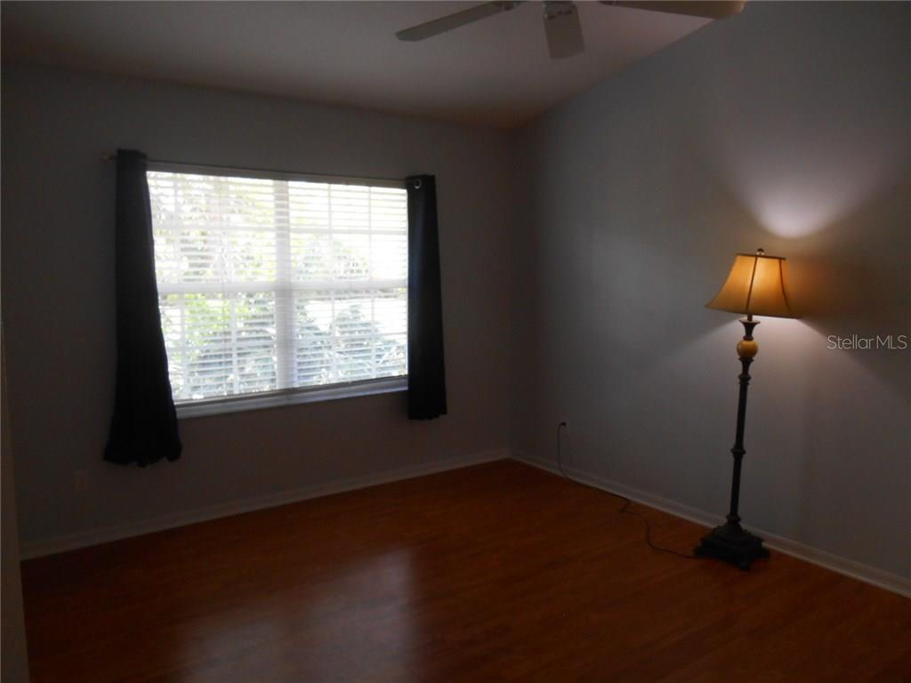 One view of the master bedroom with a nice HUGE window!  See the beginning of the vaulted ceiling here. - Condo for sale at 815 Montrose Dr #202, Venice, FL 34293 - MLS Number is A4206556