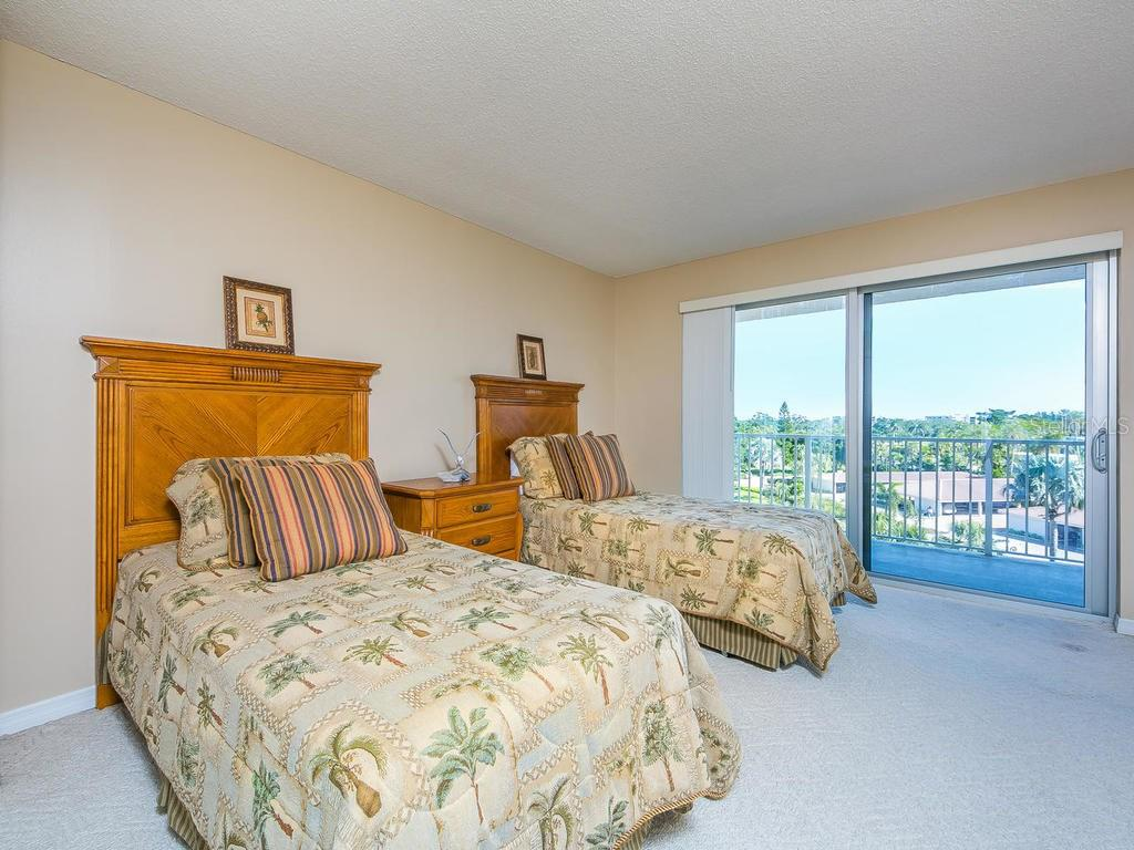 Guest bedroom with sliders to balcony - Condo for sale at 2301 Gulf Of Mexico Dr #55n, Longboat Key, FL 34228 - MLS Number is A4206569