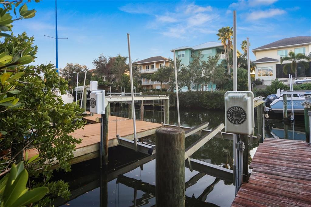 Deeded dock with 10,000 lb lift with water and electric. - Single Family Home for sale at 7047 Hawks Harbor Cir, Bradenton, FL 34207 - MLS Number is A4206626