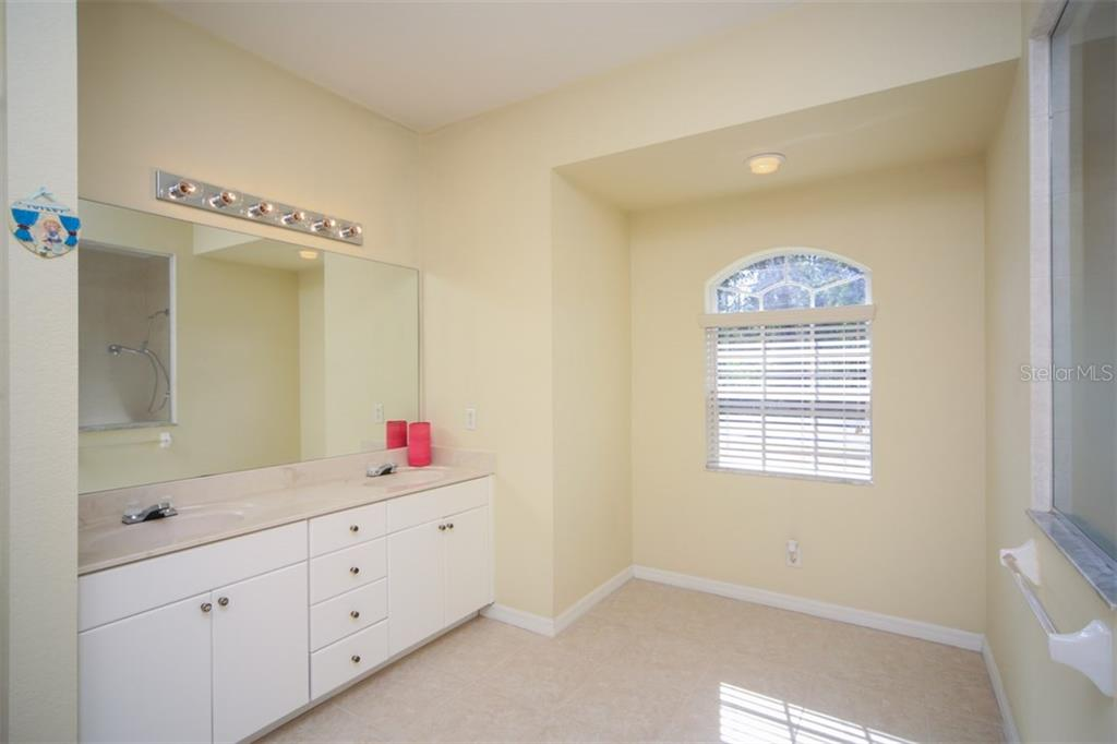 Master bathroom - Single Family Home for sale at 1876 Bushnell Ave, North Port, FL 34286 - MLS Number is A4207073