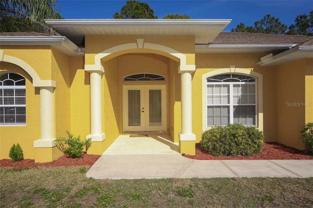 Front entry - Single Family Home for sale at 1876 Bushnell Ave, North Port, FL 34286 - MLS Number is A4207073