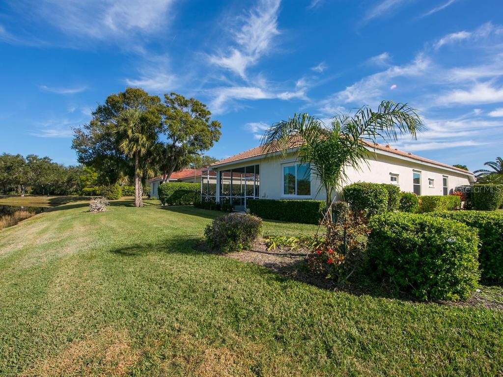 Backyard view - Single Family Home for sale at 1010 Oak Preserve Ln, Osprey, FL 34229 - MLS Number is A4207598