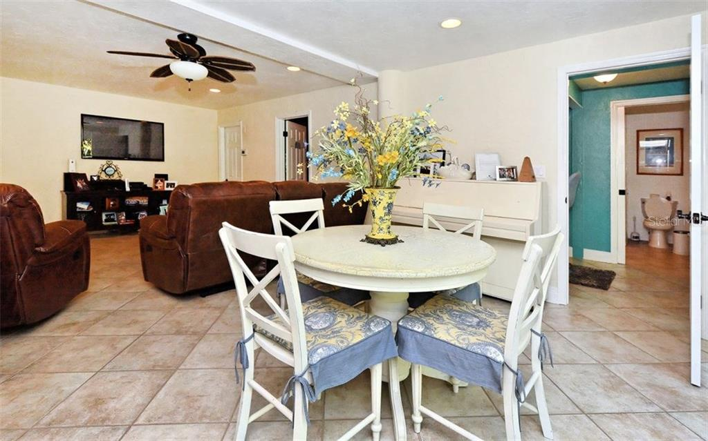 Lower level living area - Single Family Home for sale at 141 Ogden St, Sarasota, FL 34242 - MLS Number is A4208039