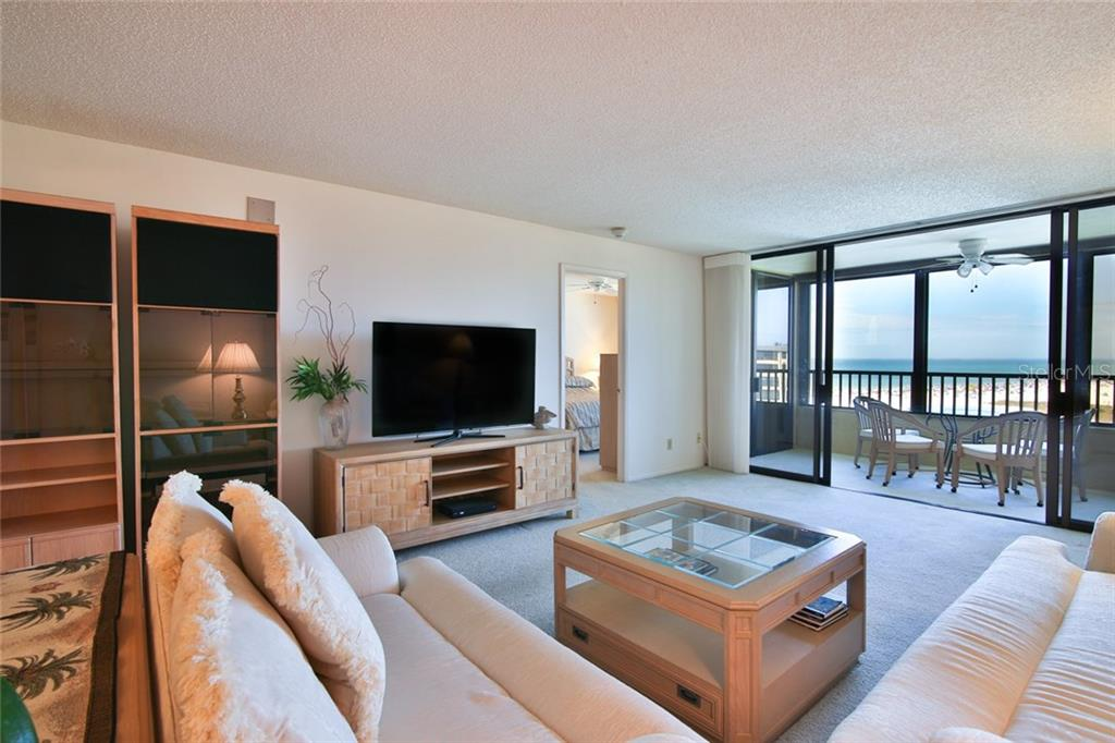 Living room view to Gulf and Master - Condo for sale at 5790 Midnight Pass Rd #704, Sarasota, FL 34242 - MLS Number is A4208095