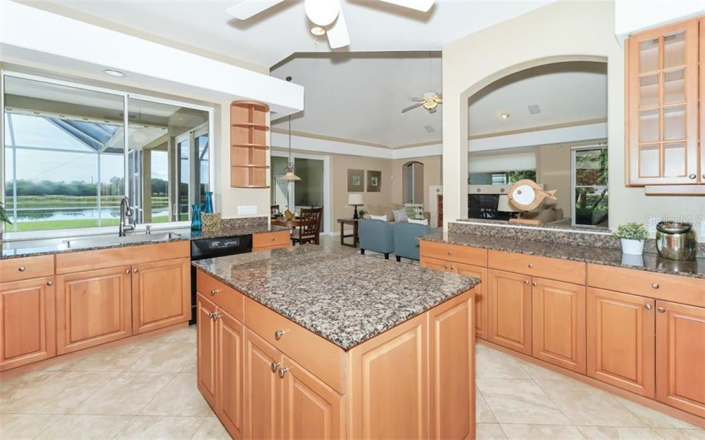 Kitchen with pass through window out to lanai dining. - Single Family Home for sale at 7389 S Serenoa Dr S, Sarasota, FL 34241 - MLS Number is A4208150