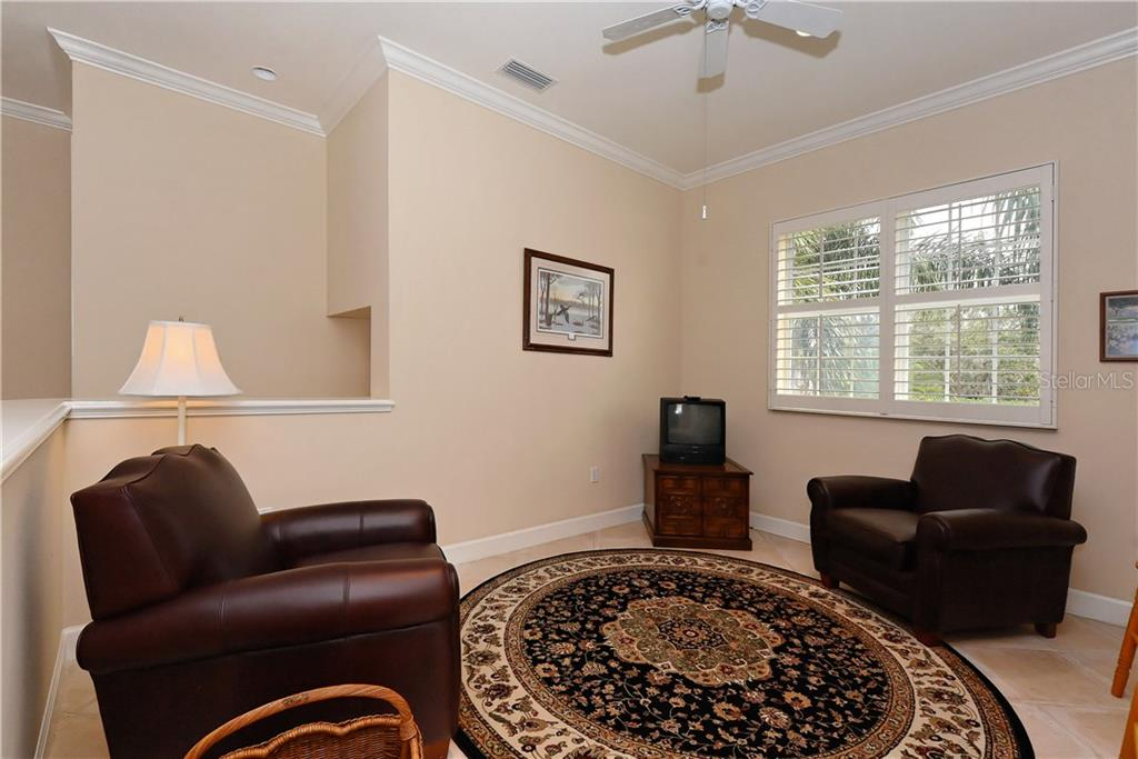 Family room. - Condo for sale at 5242 Parisienne Pl #201bd30, Sarasota, FL 34238 - MLS Number is A4208770