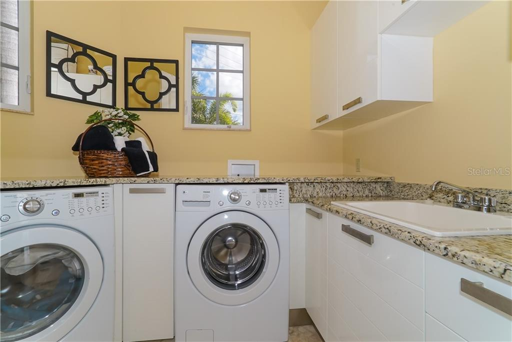 Deluxe laundry room - Single Family Home for sale at 1179 Morningside Pl, Sarasota, FL 34236 - MLS Number is A4209174