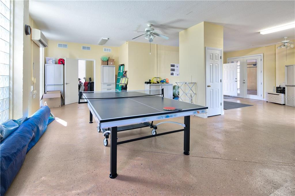 A game room in the ground level space - Single Family Home for sale at 4811 64th Dr W, Bradenton, FL 34210 - MLS Number is A4209313