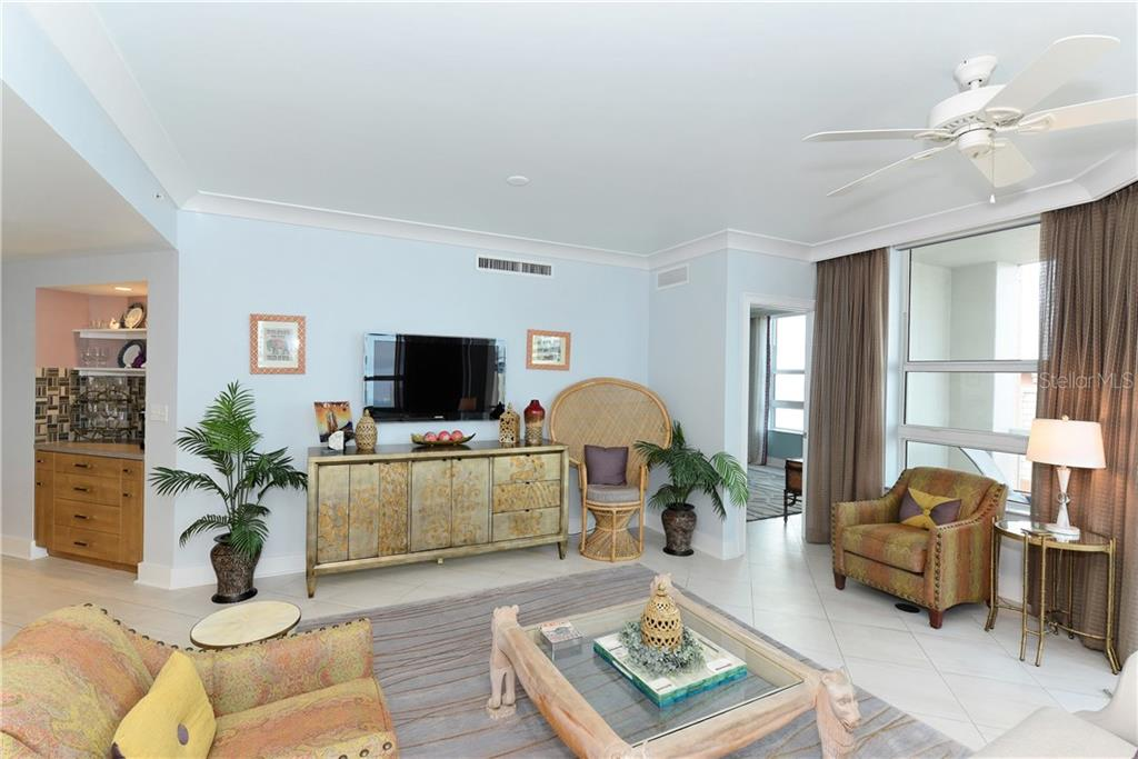 Living room and entertainment center. - Condo for sale at 1350 Main St #1106, Sarasota, FL 34236 - MLS Number is A4209424