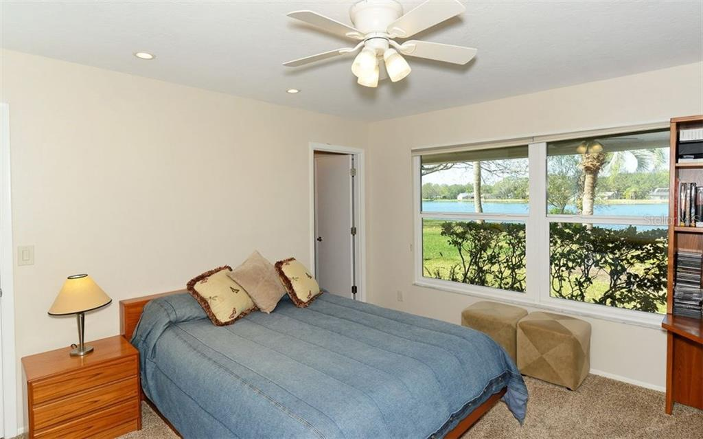 First level bedroom with private ensuite & water views is ideal for guests or in-law suite. - Single Family Home for sale at 5122 Willow Leaf Dr, Sarasota, FL 34241 - MLS Number is A4209555