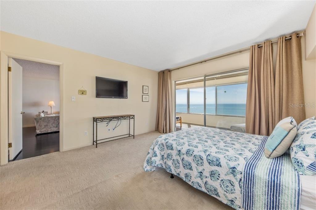 Master bedroom with wall mounted TV and look at those views! - Condo for sale at 6140 Midnight Pass Rd #608, Sarasota, FL 34242 - MLS Number is A4209897