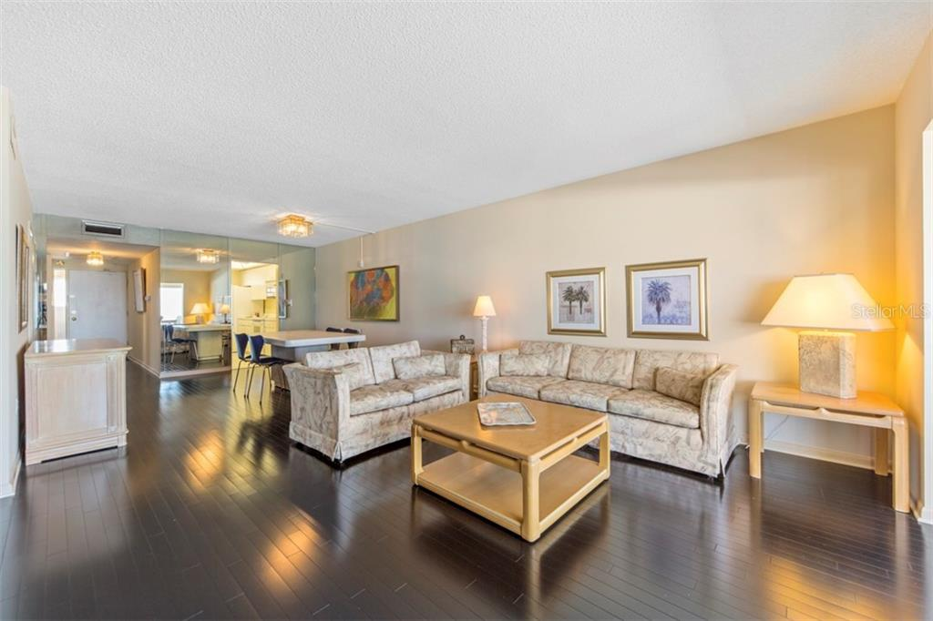 Living room & dining room - Condo for sale at 6140 Midnight Pass Rd #608, Sarasota, FL 34242 - MLS Number is A4209897