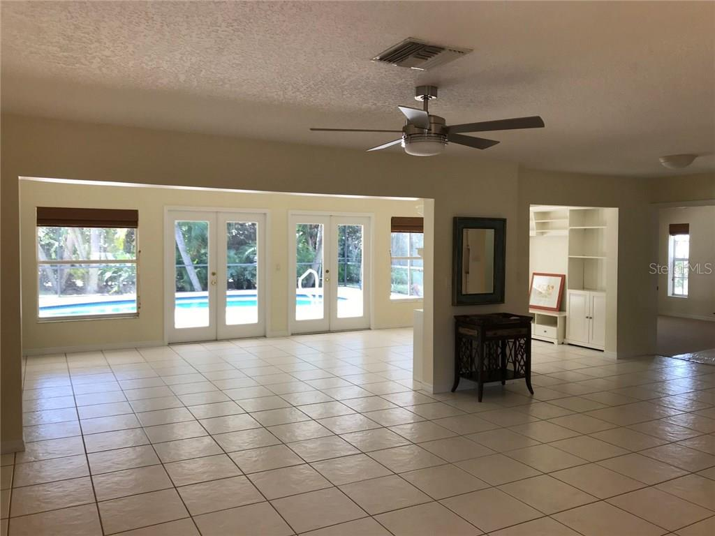 Great room with double French doors to caged swimming pool and lanai - Single Family Home for sale at 5530 Cape Leyte Dr, Sarasota, FL 34242 - MLS Number is A4209986