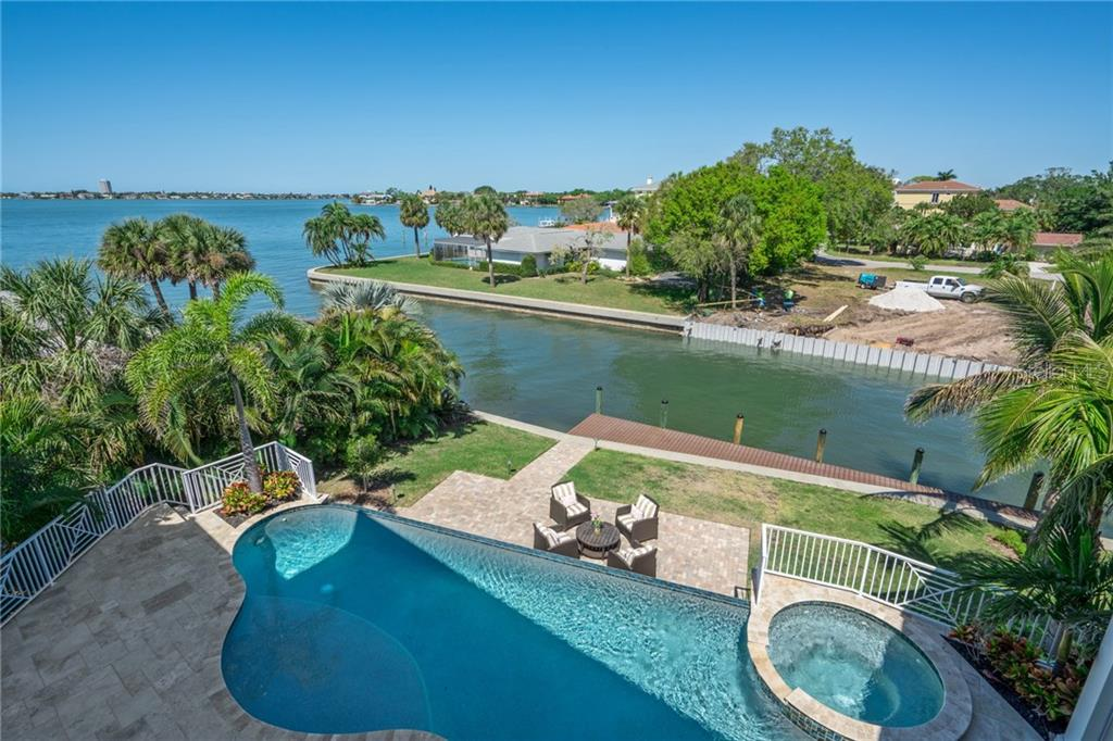 Upper level views of Swimming pool, canal and bay - Single Family Home for sale at 1503 Blue Heron Dr, Sarasota, FL 34239 - MLS Number is A4212851