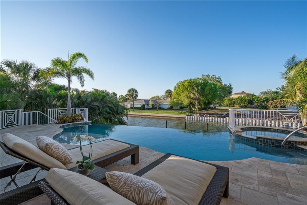 Infinity edge swimming pool and spa overlooking canal - Single Family Home for sale at 1503 Blue Heron Dr, Sarasota, FL 34239 - MLS Number is A4212851