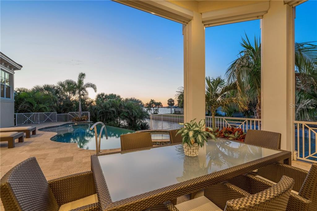 Patio overlooking infinity edge pool with view out to bay - Single Family Home for sale at 1503 Blue Heron Dr, Sarasota, FL 34239 - MLS Number is A4212851